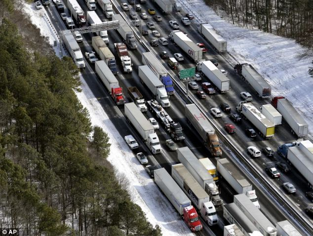 Contrast: An image from January 29 shows the lines of cars stuck on Interstate 285 in the last storm