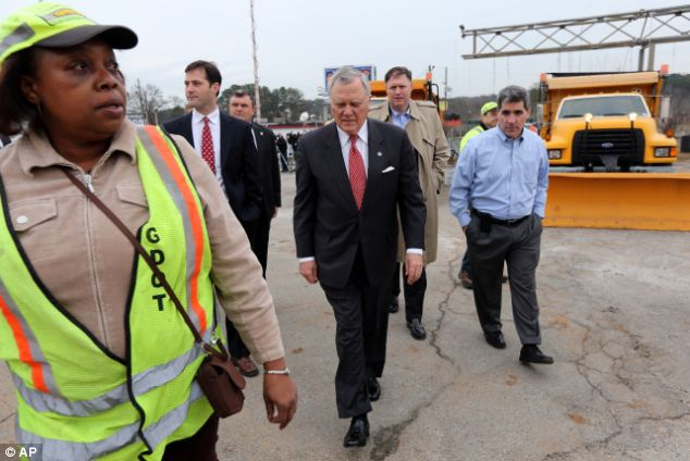 Promises: Georgia Gov. Nathan Deal (center) tours a public works facility in Atlanta on Monday before holding a news conference to talk about storm preparation