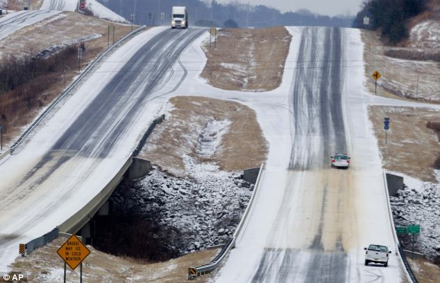 Staying home: A Lawrence County, Alabama deputy sheriff drives up an icy hill on state highway 157