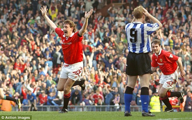 In the beginning: Steve Bruce (left) salutes the original 'Fergie Time' winner, against Sheffield Wednesday at Old Trafford in 1993, the year Ferguson won his first title