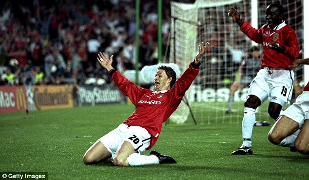Smash and grab: Ole Gunnar Solskjaer (left) celebrates his dramatic goal that won the European Cup for United