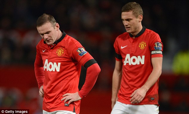 Looking down: Wayne Rooney (left) and Nemanja Vidic react after Fulham's late leveller on Sunday