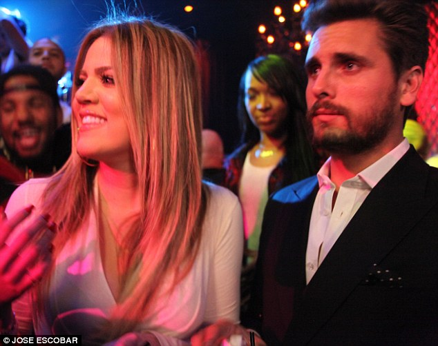 What will Kourtney say?: THe newly blonde TV icon brought along with her Scott Disick, baby daddy to her older sister