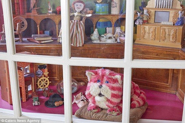 Bringing back memories: Bagpuss now has permanent residence at Canterbury Heritage Museum where the original window display for people's lost belongings featured in the show has been recreated
