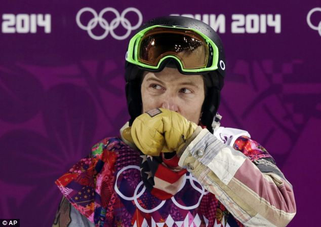 Disappointment: Shaun White wipes his face after colliding with the edge of the halfpipe course on Tuesday. Moments later, he learned that he had not won a medal in the competition