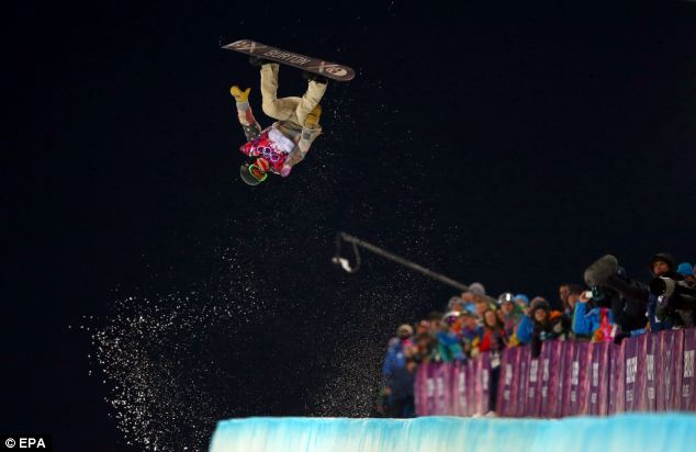 Gravity defying: White flips during the men's halfpipe in a series of impressive tricks - but it just wasn't enough