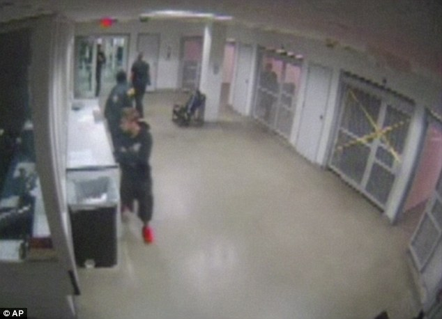 Behind bars: Footage shows Justin Bieber being frisked by Miami police after being taken into custody on January 23