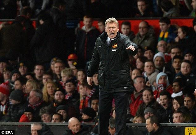 On the edge: David Moyes barks orders during United's match against Fulham on Sunday
