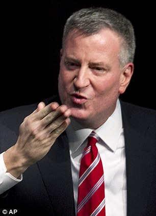New York Mayor Bill de Blasio blows a kiss to the audience after giving the State of the City address at LaGuardia Community College in the Queens borough of New York Monday
