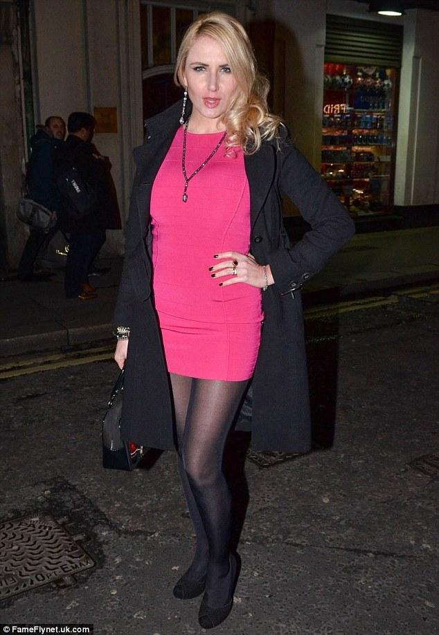 Hot pink: Nancy Sorrel looked saucy in a short fuchsia dress