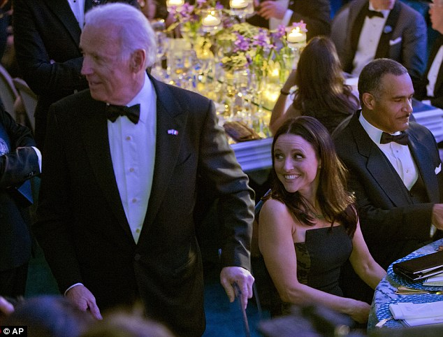 Best of friends: Julia and Joe were seated next to each other at the dinner, which was held in honour of French President Francois Hollande
