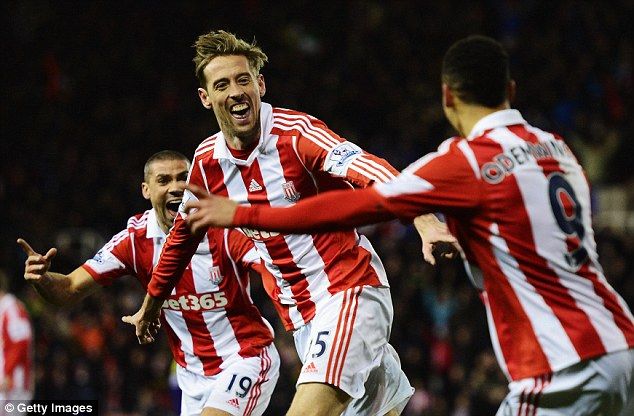 All smiles: Stoke striker Peter Crouch (centre) celebrates after putting the Potters ahead against Swansea