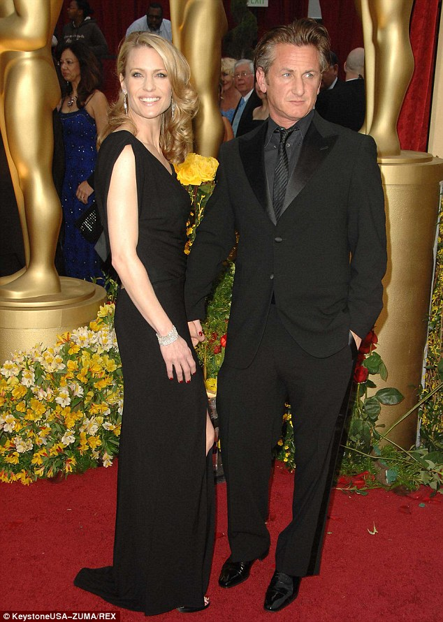 Devoted: Robin said recently that she maintained her 14-year-marriage to notoriously hot-tempered Sean Penn for the sake of their two children, the couple pictured at the Oscars in 2009