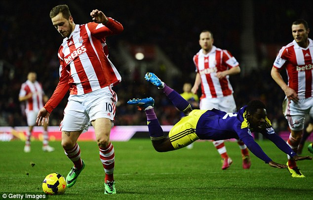 Flying: Dyer falls to the ground after being dispossessed by Stoke frontman Marko Arnautovic