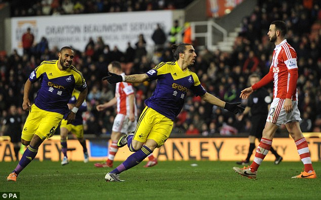 Leveller: Swansea centre back Chico Flores wheels away to celebrate after equalising for Garry Monk's side