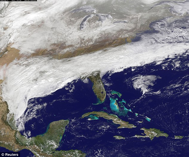 Catastrophic: Clouds associated with the major winter storm that is going to hit the South and Atlanta on Wednesday and Thursday is seen here in this NASA image taken on Tuesday
