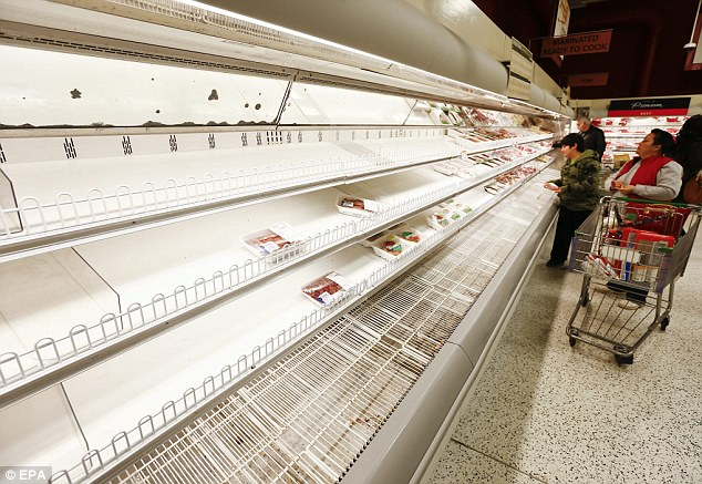 Panic buying: A Publix grocery store's depleted shelves are seen ahead of the catastrophic winter storm about to hit metro Atlanta and the South on Wednesday and Thursday