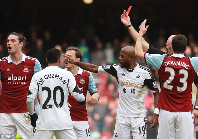 Bad times: Carroll is currently on a three-match ban after being sent off during his side's 2-0 win over Swansea