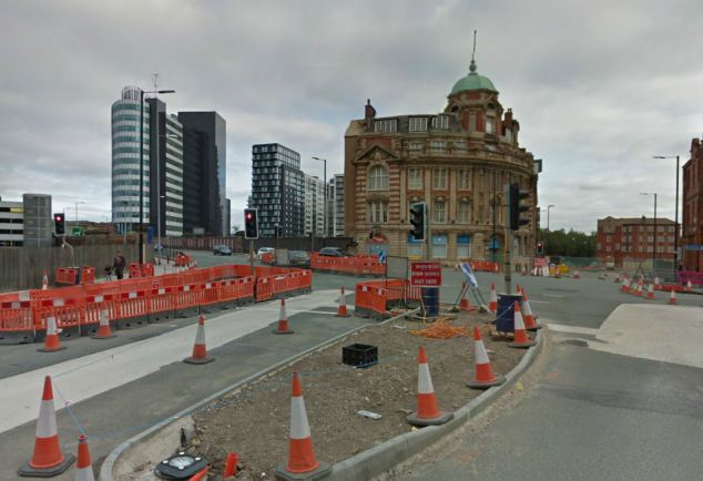 Scene: The cyclist was attacked as he waited at a set of traffic lights at this road junction in Manchester city centre