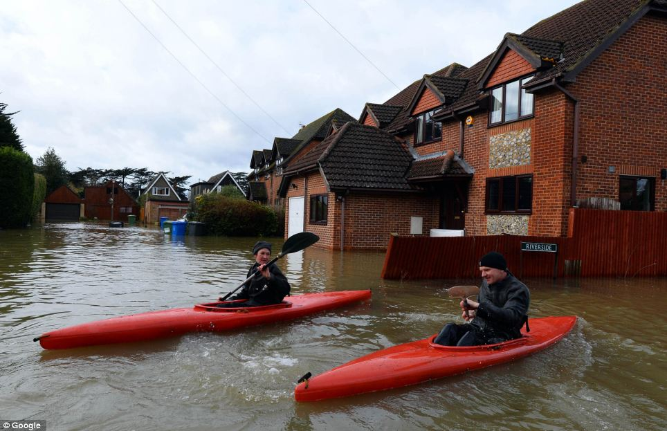 People have been forced to canoe their way around Ouseley Road, Wraysbury, after water levels rose so much