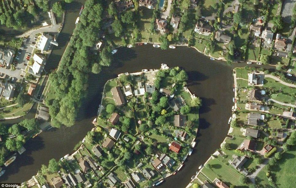 Homes normally perch on the Hamhaugh Island as the river bends around them. But many have been forced to flee following the extreme weather - which is set to continue