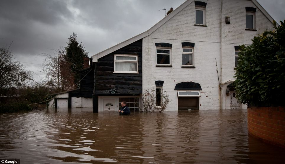 The water levels almost reached the top of the door at one cottage in Lyng, Somerset, as weeks of rain took their toll on the landscape