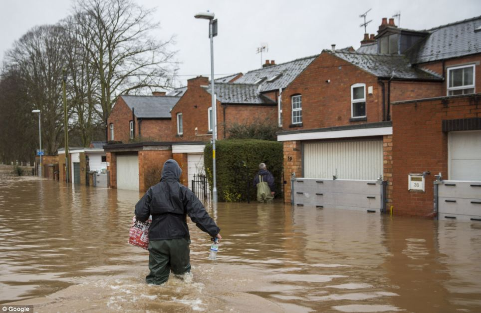 Get the waterproofs out! Waterworks Road, in Worcester, has been drowned with floods, with locals forced to wade through knee-deep water levels