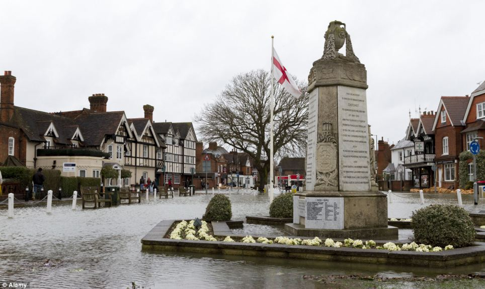 The village green, Datchet, Berkshire has been swamped by rising levels of water, forcing homeowners to flee for dry land