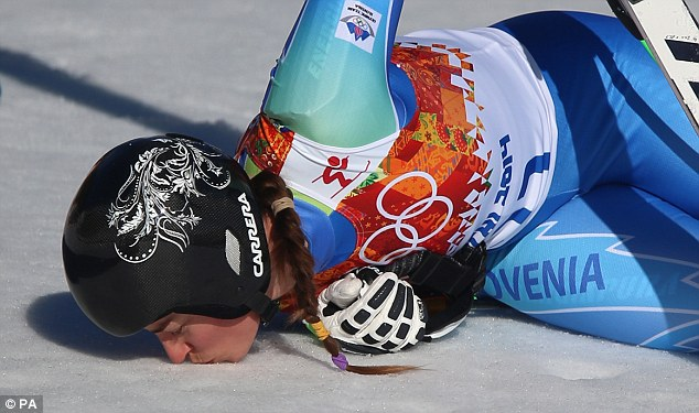 Celebrations: Maze kisses the snow after completing her run to the gold