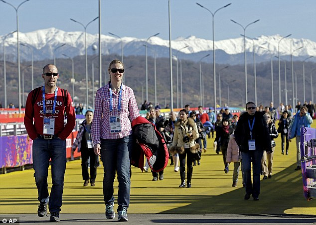 Get the shades on: Spectators carried their coats as they walked into the Olympic park. An official dismissed calls to pipe in stockpiled snow for the mountain venues, saying: 'It's no surprise... we're a subtropical city'