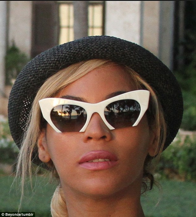 Shady lady: The songstress showed her flair for funky sunglasses