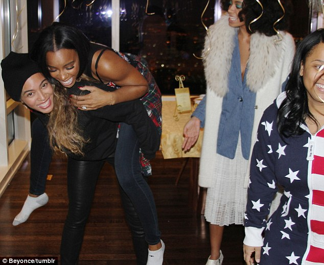 I've got your back: The Halo singer treated birthday girl Kelly to a piggyback ride
