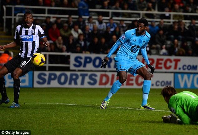 Look and learn: Sami Ameobi (L) can only watch as Emmanuel Adebayor's effort heads goalwards to make it 1-0
