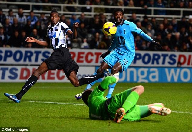 Hot Spur! Emmanuel Adebayor (R) scores his seventh goal in the last 10 games