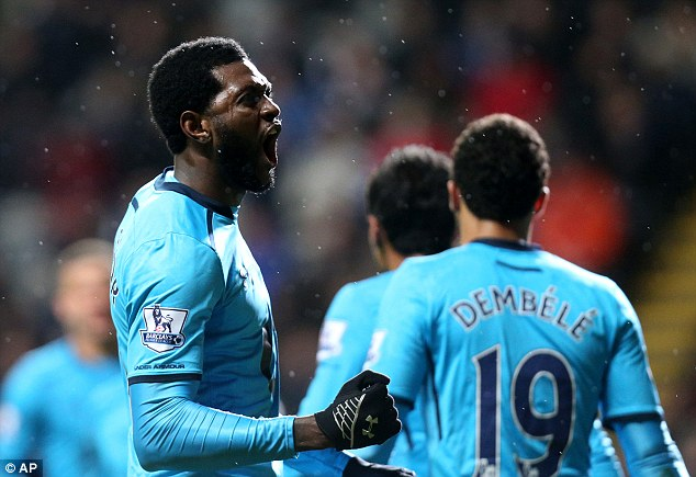 Are you watching AVB? Emmanuel Adebayor (L) screams with delight after opening the scoring at St James' Park