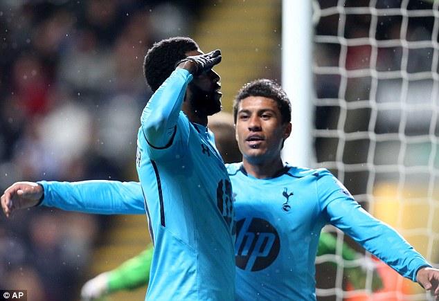 Salutes you sir! Emmanuel Adebayor celebrates his opening goal with Brazilian teammates Paulinho