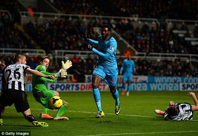 Krul intentions: Tottenham goalscorer Emmanuel Adebayor tries to walk the ball past Newcastle's keeper