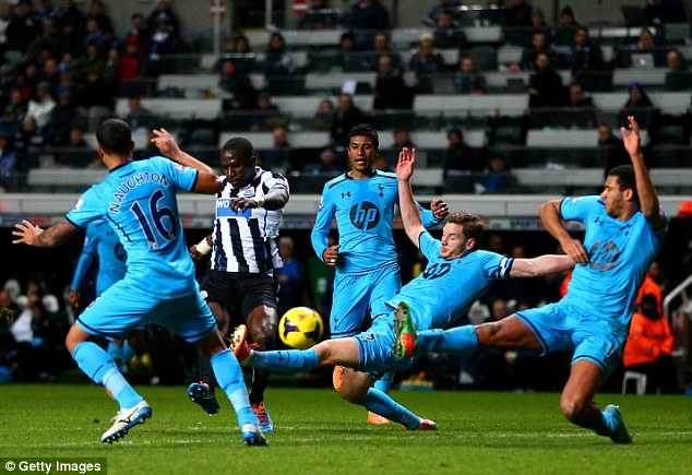 All hands to the deck: Tottenham defenders crowd out Newcastle midfielder Moussa Sissoko (C)