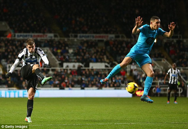 He's behind you! Nabil Bentaleb (R) turns his back on a shot from Newcastle's Mathieu Debuchy