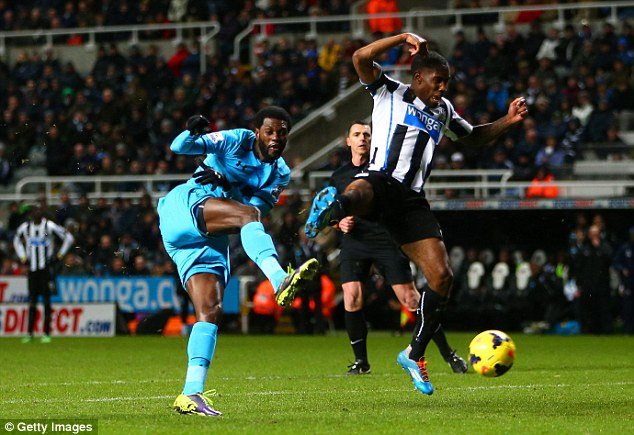 Twice as nice: Emmanuel Adebayor scored his second of the night with a mishit volley