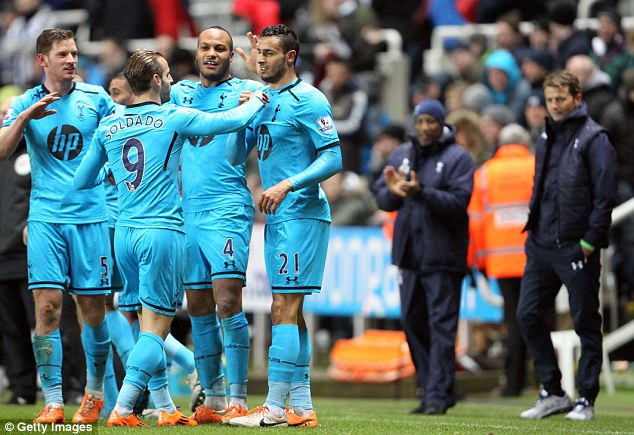 Long time coming: Spurs boss Tim Sherwood looks on as his players celebrate a first win for Spurs at St James' Park for 10 years
