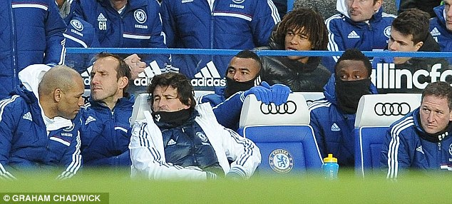 Gold reserve: Cole (centre) has spent much of his time on the Chelsea bench this season