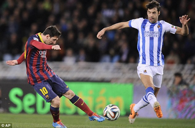 Strike: Messi (left) puts Barca into the lead, midway through the first half