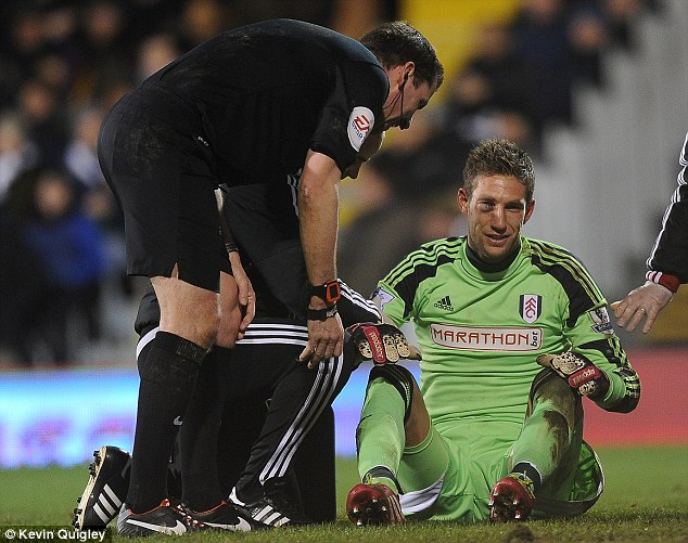 Shine on! Fulham keeper Maarten Stekelenburg (R) was left with a bruising black eye after colliding with Luis Suarez