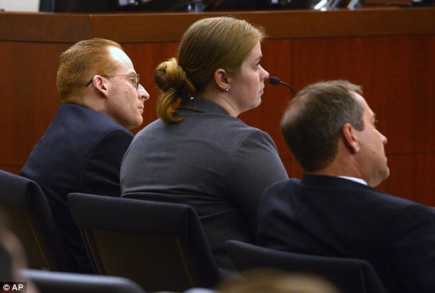 Intently listening: Eric Millerberg, (left), and his defense attorneys Haylee Mills, center, and Randall Marshall listen to opening statements by Deputy Weber County prosecuting attorney Chris Shaw on Wednesday. Millerberg's tattoo is hidden by his shirt collar