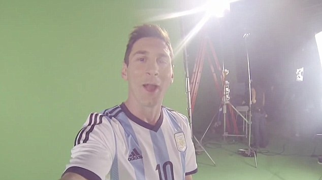 Special touch: Messi shows off his silky skills before having a knock-about with Roger Federer