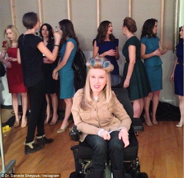 Hair and make-up: Dr Sheypuk poses backstage