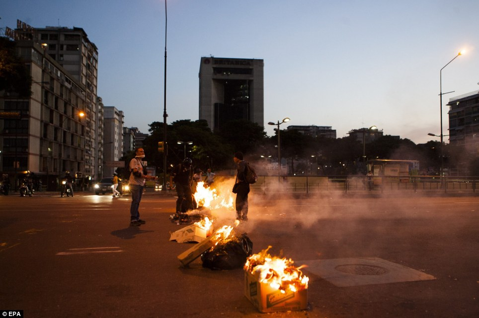 As the protests continued, demonstrators build walls of fire by burning garbage, such as here at Altamira square in Caracas