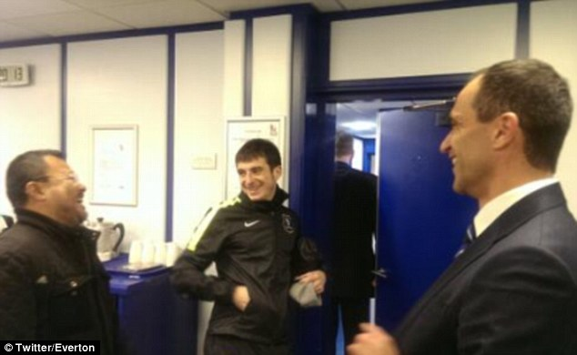 Dream come true: Mr Wee shares a joke with manager Roberto Martinez (right) and Leighton Baines (left)