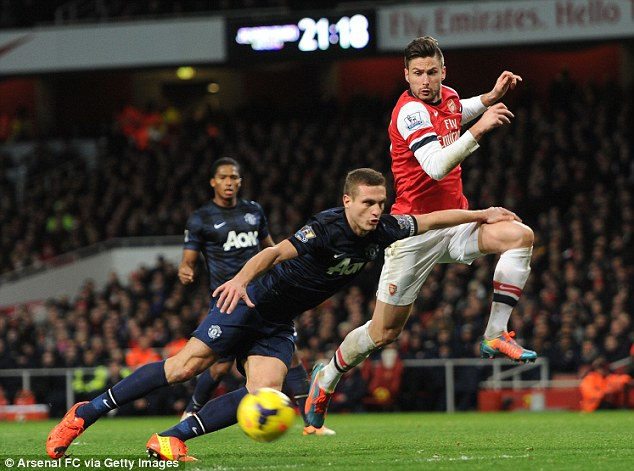 Rock at the back? Arsenal Striker Olivier Giroud trys to get to the ball ahead of Serbian defender Vidic